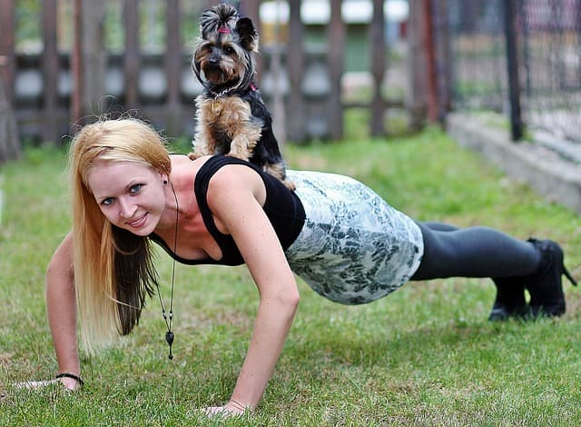 blonde woman with Yorkie